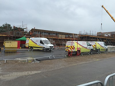 Flowscreed vans at building site