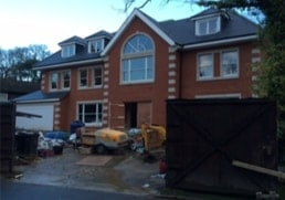 house with screed being pumped