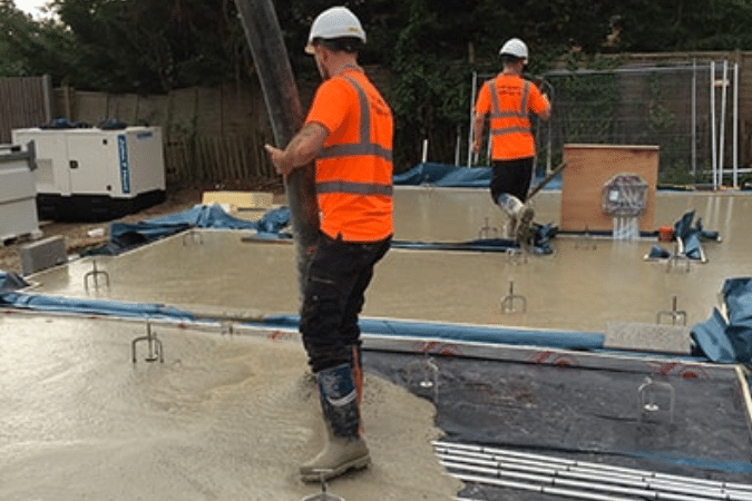 Liquid screed being pumped onto site.